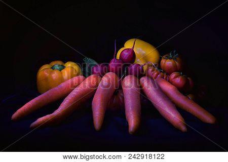 Vegetables: Yellow Bulgarian Pepper, Tomatoes, Carrots And Radish On Black Background. Stillife. Lig