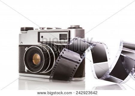 Retro Camera With Celluloid Film Isolated On White Background.