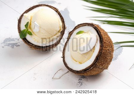 Coconut Ice Cream Scoops In Halves Of Coconut Shell On White Background. Copy Space