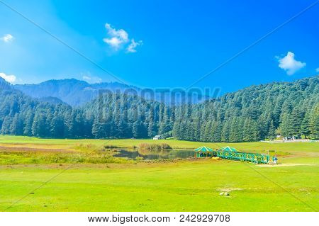 A Beautiful Golf Course On A Hill Station With Road Blue Sky Trees Clouds. Captured In Sunny Day Hil