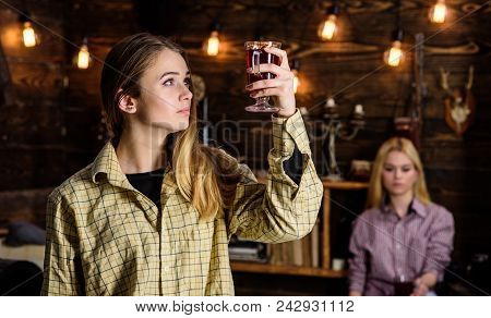 Friends Enjoy Mulled Wine In Warm Atmosphere, Wooden Interior. Friends On Relaxed Faces In Plaid Clo