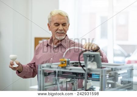 Nice Job. Upbeat Senior Man Finishing Creating A Model With A 3d Printer And Smiling Contentedly Bec