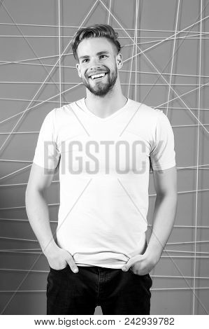 Bearded Man Smile In White Tshirt And Jeans. Happy Macho With Beard On Unshaven Face. Guy Smiling Wi