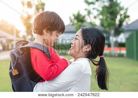 Mom Hug And Carry Her Son. Preparing To Send Her Children Back To School In Morning. Mother Playing
