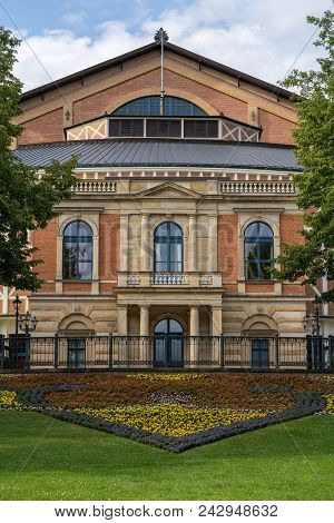 Close up from the famous bayreuth wagner festival theatre from the front with colorful flowers poster