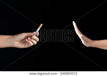World No Tobacco Day, May 31. Just Say No To Stop Smoking. Close Up Man Hand Reject Cigarette Offer