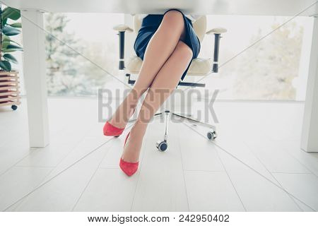 Cropped Front View Portrait Bottom View Of Woman's Legs Wearing Black Skirt Red High Heels Shoes Sit