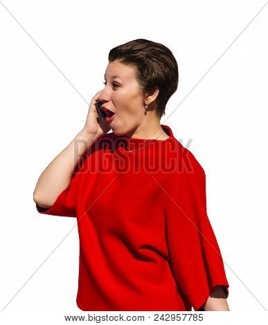 Woman In A Red Suit Talking On The Phone With A Comical Rapturous Expression, Isolated On White Back