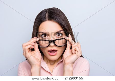 Portrait Of Impressed, Shocked, Angry, Stressed Woman Holding Eyelets Of Glasses On Her Face With Tw