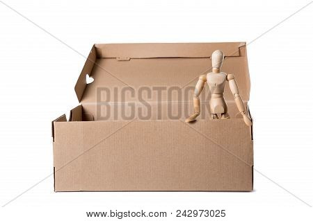 Brown Cardboard Box With Wooden Mannikin Standing In It. Concept Of Thinking Outside The Box, Freedo