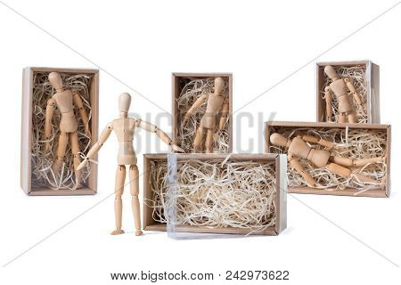 Wooden Mannikin Is Standing Near Open Cardboard Box Filled With Wood Shred While Others Are Remainin