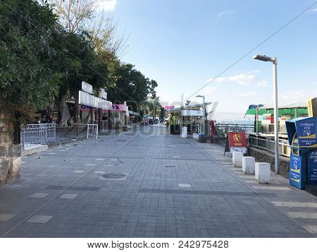 Tiberias, Israel - May 13, 2018: Seaside Promenade On The Sea Of Galilee. The Areas Is Lined With Ho