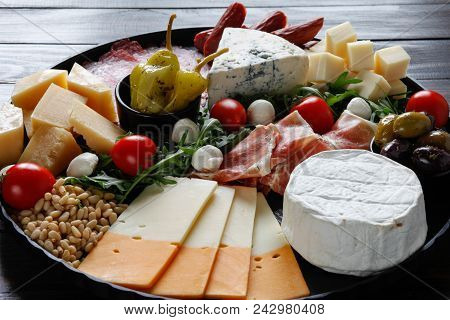 Chesse Platter With Cheese, Prosciutto, Tomato, Nuts. Healthy Eating, Dairy, Chesses And Meat. Antip
