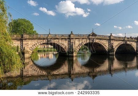 View Of River Severn And English Bridge In Shrewsbury Shropshire With Retirement Apartments In Backg