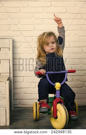 Child Childhood Children Happiness Concept. Happy Childhood Concept. Baby Cyclist With Long Blond Ha
