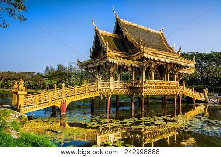 Amazing View Of Beautiful Golden Bridge And Pavilion Of The Enlightened With Reflection In The Water