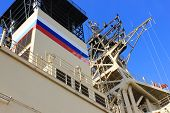 Russian Navy Ship Fragment with Russian Flag Painted on Outdoor Deck. Naval Marine Ship Detail, Russian Icebreaker Ship in Dock against Blue Sky Backgorund. poster