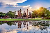 Buddha statue and Wat Mahathat Temple in the precinct of Sukhothai Historical Park, Wat Mahathat Temple is UNESCO World Heritage Site, Thailand. poster
