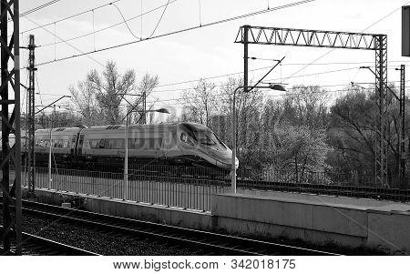 Warsaw,poland. July 2015. The Pendolino Train Travels Along The Tracks At The Warszawa Stadion Stati