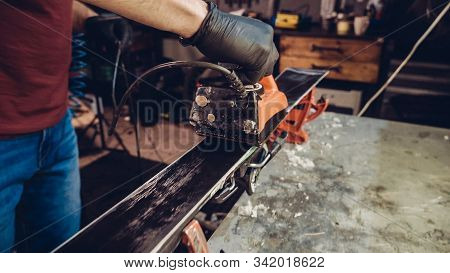 Applying Hot Wax To Ski Base With Iron. Applying Ski Wax To Ski Base. Ski Base Tuning. Ski Wax Iron