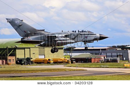 RAF Tornado jet fighter aircraft coming in to land at the RAF base at Lossiemouth in Morayshire, Scotland. poster
