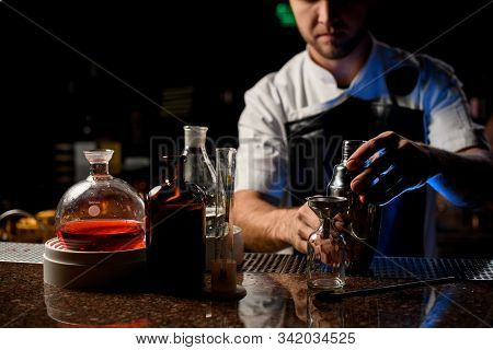 Professional Male Bartender Holding In Hands A Steel Shaker Open It Near The Bartender Equipment