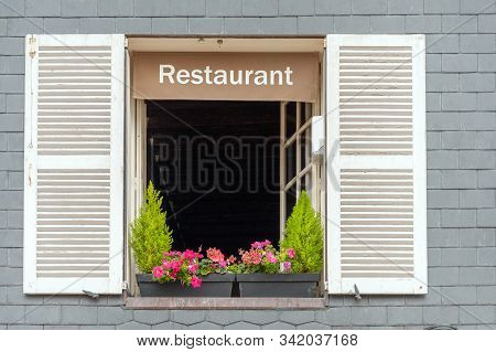 Cozy French Restaurant Window Of Typical House In Oceanside Village, Normandy, France