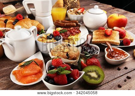 Breakfast Served With Coffee, Orange Juice, Croissants, Cereals And Fruits. Balanced Diet. Continent