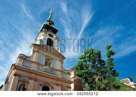 Tower Of Stiftskirche Church On Mariahilfer Strasse In Vienna