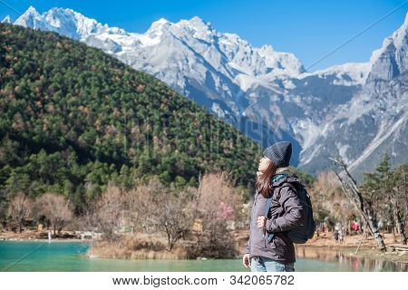Young Woman Traveler Traveling At Blue Moon Valley, Landmark And Popular Spot Inside The Jade Dragon