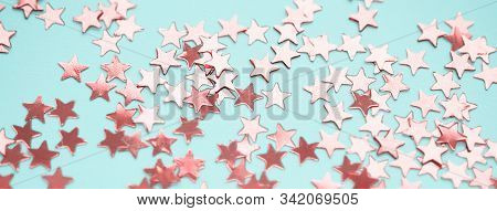 Golden Stars Glitter On Blue Background. Festive Holiday Bright Backdrop. Social Media Banner Or Hea