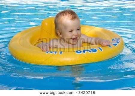 Beautiful Baby Girl Having Fun In The Family Pool