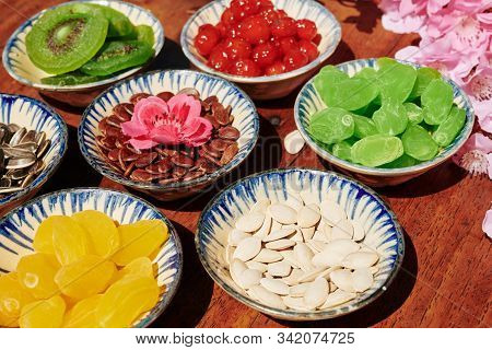 Traditional Tet Snacks: Dried Fruits And Berries And Various Seeds In Small Bowls