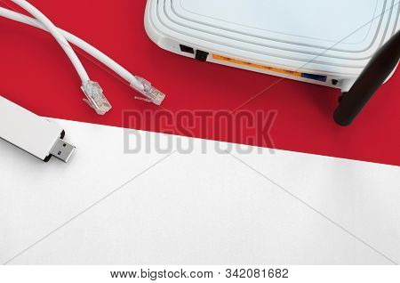 Indonesia Flag Depicted On Table With Internet Rj45 Cable, Wireless Usb Wifi Adapter And Router. Int