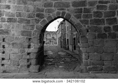 Ancient Medieval Gate In The Historical Town Of San Felices De Los Gallegos. Spain.