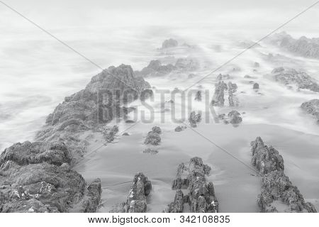 Cantabrian Sea. Landscape With Fog In The Portio Beach. Liencres. Cantabria. Spain.