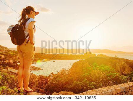 Girl Looking At Capo Ferro On Costa Smeralda Sardinia Italy