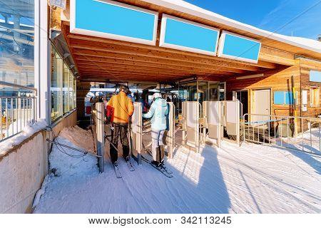 People On Ski At Ticket Gate In Penkenbahn Station Austria