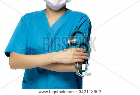 Surgeon Doctor Or Nurse Wear Blue Scrubs Uniform And Pink Face Mask. Physician Stand With Arms Cross