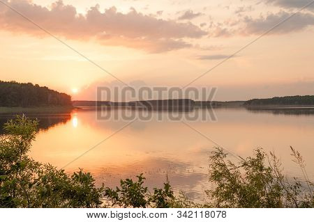 Sunset Over Tranquil Waters Of Picturesque Lake Surrounded By Forest In Zhytomyr Region, Ukraine