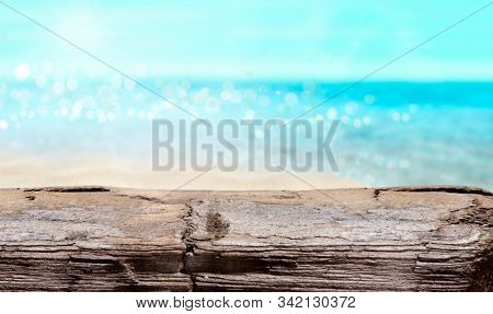 A piece of old wood washed up on the sea shore. Macro photo. Summer on a tropical beach.