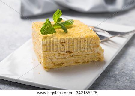 Napoleon Cake. Piece Of Cake Napoleon On White Plate On Concrete  Background, Close Up View. Traditi