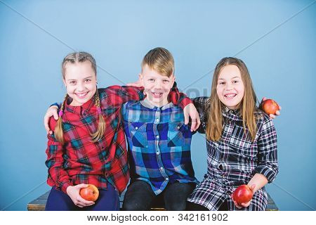 Having Tasty Snack. Group Teenagers Eat Apples. Boy And Girls Friends Eat Apple Snack. Teens With He
