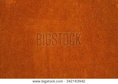 Rust And Oxidized Metal Brown Texture. Rusted Orange Grunge Metal Background. Old And Dirty Iron Bui