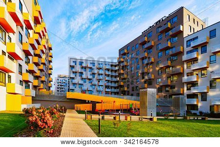 New Modern Residential Apartment Flat House Building And Child Playground Reflex