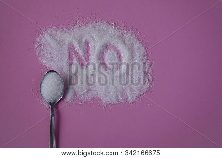 Word No Hand Written On A Heap Of White Sugar With Full Teaspoon Of Sugar On A Pink Background Top V