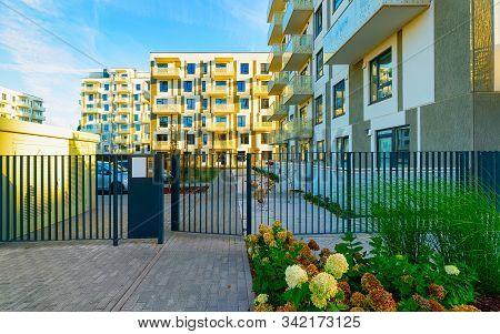 Modern New Residential Apartment House Building With Entrance Gate Reflex
