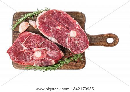 Raw Lamb Ham Meat On A Bone On Wooden Cutting Board With Herbs And Spices Isolated On White Backgrou