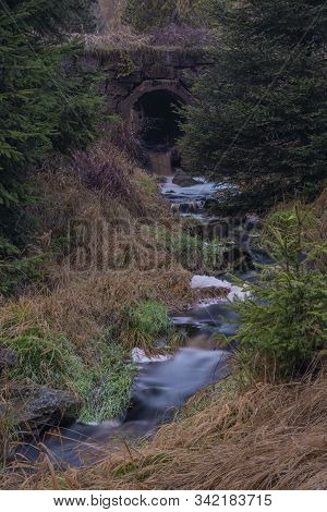 Upper Watercourse Of Creek Near Bilina River In Krusne Hory Mountains In Evening