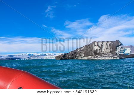 Boat Floating In The Arctic Lake